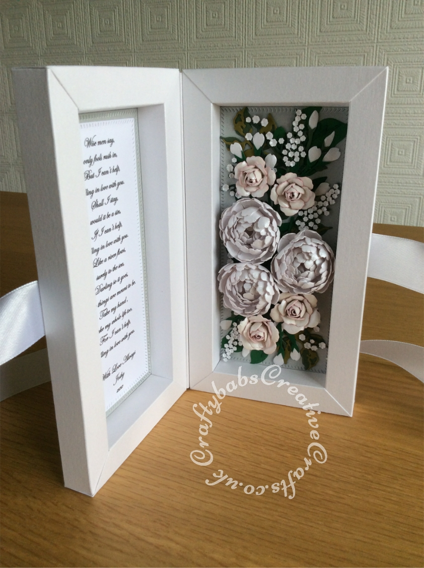First Wedding Anniversary shadow box card replicating flowers in the bridal bouqet made using various dies including Tonic Shadow Box Creations die set, Heartfelt creations Majestic Blooms Die, Cheery Lynn Baby's breath flower die, Memory box Norrland flower dies, Altenew Garden Picks die set, Alt-e-new Layered Rose die set, free with issue 174 of Simply Cards & Papercraft magazine and Britannia Sentiment dies. - craftybabscreativecrafts.co.uk