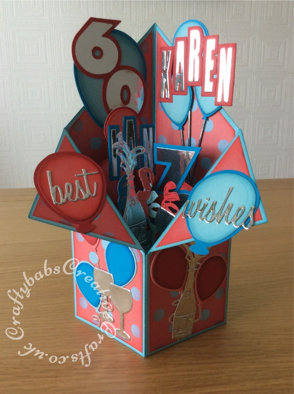 Tuxedo Pop up box Joint 60th & 70th birthday card made using various dies including Sizzix Originals Shadow Box numbers dies, wine glass die from free gift in Simply Cards and Paper Craft magazine issue 161, Quickutz cookie cutters nesting balloons die set, Fuzzy Lemon bunch of balloons die, Sizzix thinlits Tim holtz Celebration words script dies, Champagne bottle die from the Tattered Lace Championship die set, streamers die from The Tattered Lace Cocktail time die set and the Crealies Alfies alphabet die set CLALF03. - craftybabscreativecrafts.co.uk