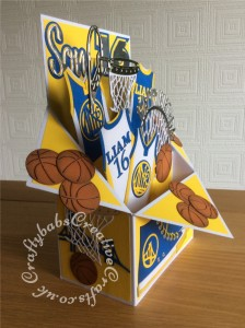 Large Basketball themed Pop Up Box Card made using various dies including; MFT All Star High Tops die set, Vintage Basketball Net (TLD0358), Sports Pack Metal Die set Cheery Lynn Dies B553, Championship die set (457861) – Tattered Lace, Sentiment from the Tattered Lace Zig Zag cascade card die set, Paper Boutique male relatives die and Sizzix originals Shadow Box Number dies. - craftybabscreativecrafts.co.uk