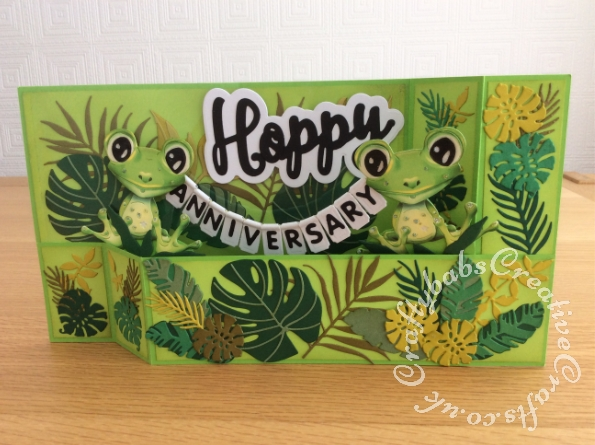 Wiper card Frog Themed Anniversary card made using various dies including: Tattered Lace Freda Frog die (439204) various tropical leaf dies from a number of different sets including; Sizzix Thinlits Die Set 18PK - Jungle Shadow Box, Altenew Hibiscus Garden 3D die set and free die set from issue 205 of Simply Cards & Papercraft, Creative Die Set Sorry, Love & Happy Sentiments Set from Craftstash and Sweet Dixie 'Teachers Pet' alphabet dies. - craftybabscreativecrafts.co.uk