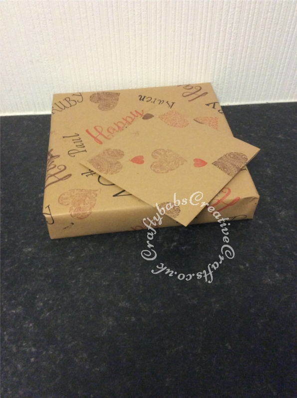 Hand stamped wrapping paper using various stamps and plain brown paper - craftybabscreativecrafts.co.uk