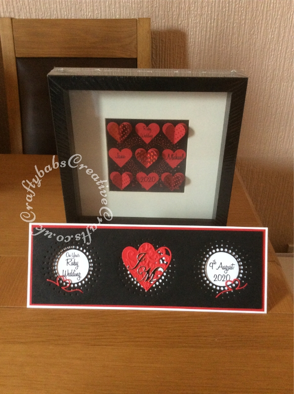 40th Ruby Wedding Anniversary Card and picture, Card made using a variety of dies including Memory Box sun burst, Marianne hearts, frantic stamper ribbon heart and Cheery Lynn Alphabet dies. Greeting printed. Picture made using Spellbinders nesting hearts dies and various foil press dies in IKea Ribba Box frame - craftybabscreativecrafts.co.uk