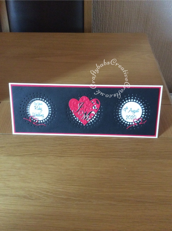 40th Ruby Wedding Anniversary Card made using a variety of dies including Memory Box sun burst, Marianne hearts, frantic stamper ribbon heart and Cheery Lynn Alphabet dies. Greeting printed. - craftybabscreativecrafts.co.uk