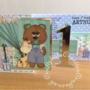 Ist birthday Boy Z Fold card made using various unbranded bear, bear outfit, giraffe and parcel dies, Alphabet balloons dies from The Works and Sizzix Bigz Sassy Serif Numbers dies - craftybabscreativecrafts.co.uk