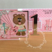 Ist birthday Girl Z Fold card made using various unbranded bear, bear outfit and parcel dies, Alphabet balloons dies from The Works and Sizzix Bigz Sassy Serif Numbers dies and Die Monde custom made wooden bear and bunny die. - craftybabscreativecrafts.co.uk