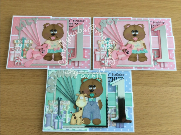 Ist birthday Triplets Z Folds card made using various unbranded bear, bear outfit, giraffe and parcel dies, Alphabet balloons dies from The Works and Sizzix Bigz Sassy Serif Numbers dies and Die Monde custom made wooden bear and bunny die. - craftybabscreativecrafts.co.uk