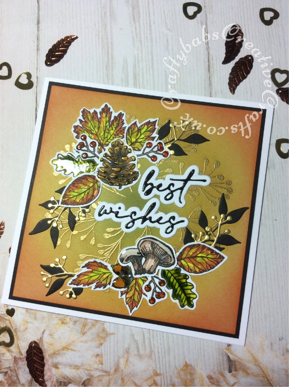 Best Wishes card made using the free Autumn Days stamp set from issue 208 of Simply Cards & Papercraft magazine, Versafine Onyx Black ink, gold embossing powder, spectrum aqua pens, Hunkydory Prism watercolour brush markers, Tim Holtz distress inks, Ranger Glossy accents, altenew leaf die and unbranded sentiment and berries dies. - craftybabscreativecrafts.co.uk