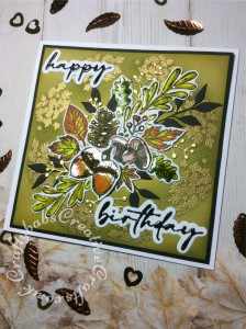 Birthday card made using the free Autumn Days stamp set from issue 208 of Simply Cards & Papercraft magazine, Versafine Onyx Black ink, gold embossing powder, spectrum aqua pens, Hunkydory Prism watercolour brush markers, Tim Holtz distress inks, Ranger Glossy accents, altenew leaf die and unbranded sentiment and berries dies. - craftybabscreativecrafts.co.uk