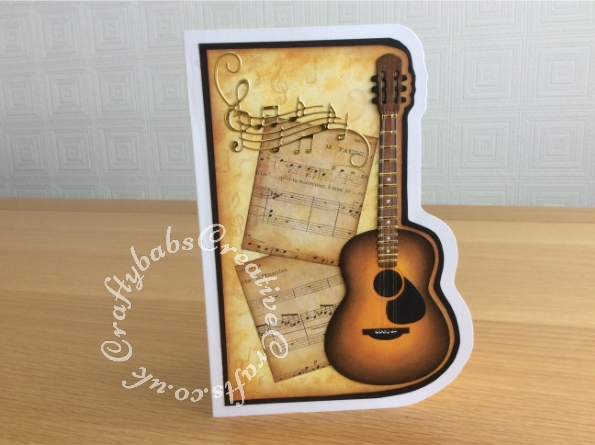Guitar music themed card made using the contents of the Papercraft Society Box June 2020 Olga Direktorenko - plus - distress inks, black card stock, white card stock and nylon thread. - craftybabscreativecrafts.co.uk