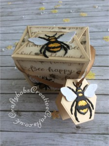 """Bee Happy boxes made using: the Memory Box Small Takeout Box die, the Bee die from The Indigo Blu mixed media Special magazine kit issue one multicut from yellow, black and white card stock, the small bee die and Bee happy stamp from the free cover gift of Issue 163 of Papercraft Essentials magazine . The tag was made using a die from a set of nesting hexagons dies. The glittered patterned paper was from the Docrafts Premium 12"""" Bee Happy paper pad. I added stickles glitter and glossy accents to the larger bees. - craftybabscreativecrafts.co.uk"""