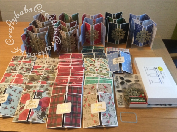 Pop out gate fold Christmas cards made with adaptables card bases from Limetree Craft and various patterned papers. Front Greeting Stamped using Merry Christmas stamp from Creative Stamping Special Edition boxed kit issue 1 and heat embossed with gold glitter embossing powder. Sentiment die cut with unbranded stitched edge rounded corner rectangle die. Snowflakes are Christmas decorations attached to the card base. - craftybabscreativecrafts.co.uk