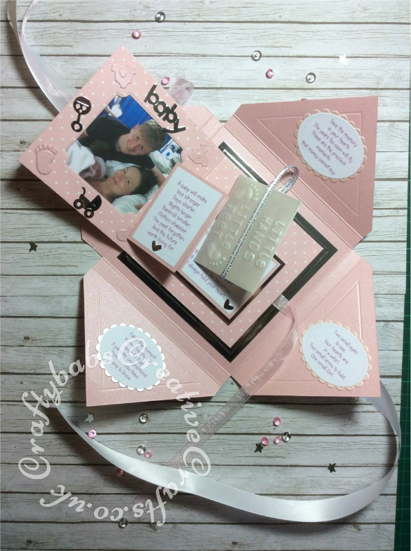Baby Girl Birth keepsake made using a variety of dies including: Tattered Lace Essentials Die - Notched Squares ETL311, Quickutz nesting Tag dies, Lettering created using Memory box Alphabet soup upper case and lower case alphabet dies, Ellison thick cutz envelope die, Cuttlebug baby elements die, Marianne baby feet dies, Spellbinders nesting plain & scalloped oval dies, Parchment pocket made using an envelope template stencil, baby clothes and baby words embossed using brass stencils, outer cover embossed using score board. - craftybabscreativecrafts.co.uk