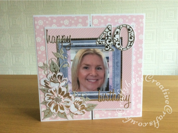 40th Birthday CRazy shutter card. The base card is a crazy shutter card made using instructions from the Crafters Companion Big Score board dvd. I used Sizzix Tim Holtz celebrate and friends script sentiment dies and Tattered Lace character sentiments dies, Large letters and numbers cut with Card Making Magic Alphabet and numbers plain and overlay dies. Flowers made with Spellbinders Glimmered Botanical hot foil and die set. Photographs taken into Craft Artist professional to add frames. - craftybabscreativecrafts.co.uk