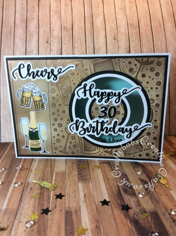 Drinks themed 30th birthday card made using carious dies and stamps including; unbranded celebration drinks bottles and glasses die & stamp set, Apple Blossom Embossing folder, beer glass stamps and die free with issue 161 of Simply Cards & Papercraft, iCraft Happy Birthday and cheers sentiment dies, Creative nesting circle dies and Sizzix Sizzlits Script numbers dies. - craftybabscreativecrafts.co.uk