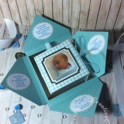 Baby Boy Birth keepsake made using a variety of dies including: Tattered Lace Essentials Die - Notched Squares ETL311, Quickutz nesting Tag dies, Lettering created using Memory box Alphabet soup upper case and lower case alphabet dies, Ellison thick cutz envelope die, Cuttlebug baby elements die, Marianne baby feet dies, Spellbinders nesting plain & scalloped oval dies, Parchment pocket made using an envelope template stencil, baby clothes and baby words embossed using brass stencils, outer cover embossed using score board. - craftybabscreativecrafts.co.uk