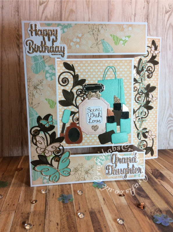 Cosmetic and perfume themed birthday card made using various dies including: Spellbinders Romantic vines die set, Handbag from Tattered Lace Shopping (457862) die set, Lip stick and nail polish from Sizzix Sizzlits X 4 Glam Girl Set , Perfume bottle die from Hunkydory Design Collection Box Magazine Issue 8, Poppystamps Die set Devyn Butterfly Trio 1378, and set 1389 ~ EMELIA BUTTERFLY TRIO, Sizzix Sizzlits Script alphabet dies, Hunkdory Moonstone Simply sentiments dies and Paper Boutique sentiment dies. - craftybabscreativecrafts.co.uk
