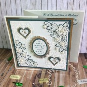 """Large 8"""" square Wedding card made using a variety of dies including Tattered Lace double delights adore & Kaleidoscope flower corner dies, Spellbinders floral and plain nesting ovals & scalloped and plain nesting hearts. Sentiment printed, monograms die cut using Britannia Dies alphabet dies and layered onto hearts using spellbinders nesting plain and scalloped hearts dies. - craftybabscreativecrafts.co.uk"""
